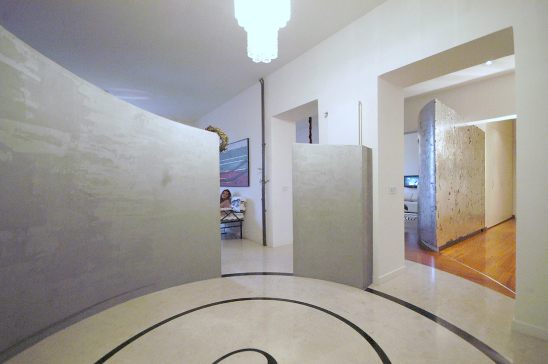 curved wall_ gray_ stone_entrance hall